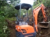 With a small digger operated by Peter MacPherson